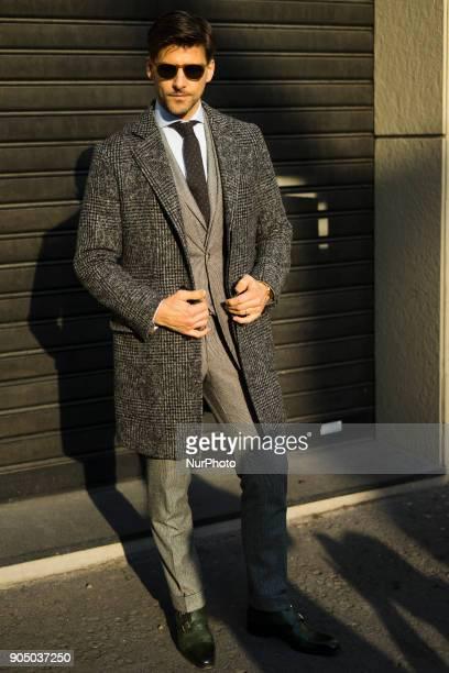 Johannes Huebl wearing grey suit grey coat is seen outside Daks during Milan Men's Fashion Week Fall/Winter 2018/19 on January 14 2018 in Milan Italy