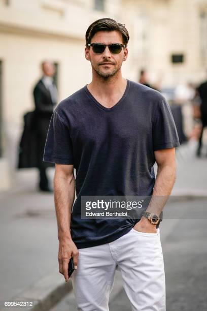 Johannes Huebl wears sunglasses, and a t-shirt, outside the Valentino show, during Paris Fashion Week - Menswear Spring/Summer 2018, on June 21, 2017...