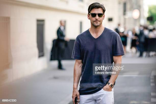 Johannes Huebl wears sunglasses and a tshirt outside the Valentino show during Paris Fashion Week Menswear Spring/Summer 2018 on June 21 2017 in...