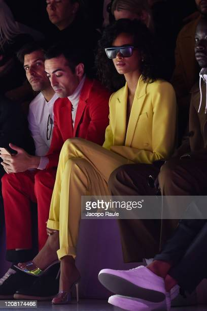 Johannes HueblMohammed Al Turki and Cindy Bruna attend the Boss fashion show on February 23 2020 in Milan Italy