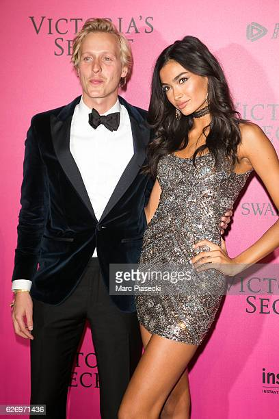 Johannes Jarl and Kelly Gale attend '2016 Victoria's Secret Fashion Show' after show photocall at Le Grand Palais on November 30 2016 in Paris France