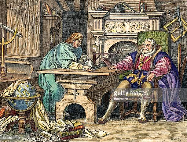 Johannes Kepler German astronomer is shown discussing his discoveries of planetary motion with his sponsor Emperor Rudolph II