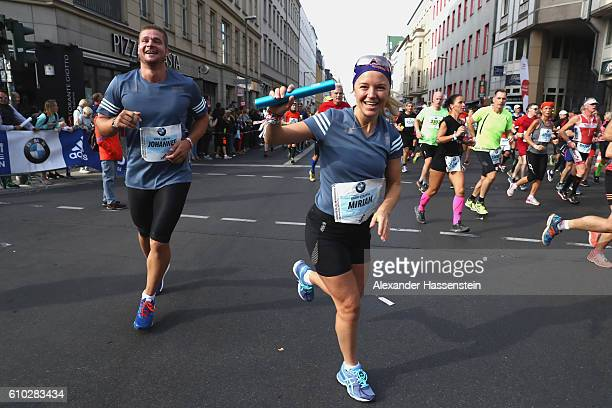 Johannes Lochner of the BMW Wintersport relay hands over to his team mate Miriam Goessner during the 43 BMW Berlin Marathon on September 25 2016 in...