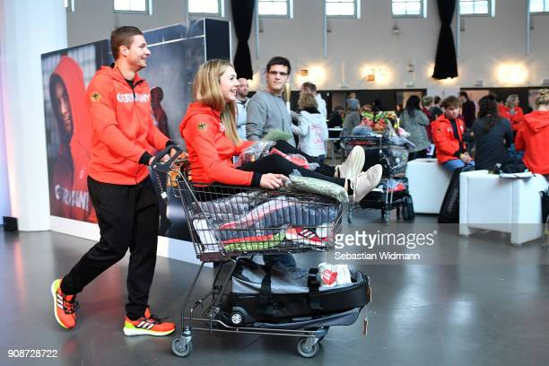 Johannes Lochner pushes Carolin Langenhorst in a shopping cart during the 2018 PyeongChang Olympic Games German Team kit handover at Postpalast on...