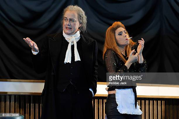 Johannes Martin Kranzle as Don Alfonso and Sabina Puertolas as Despina in the Royal Opera's production of Wolfgang Amadeus Mozart's Cosi Fan Tutte...