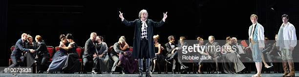 Johannes Martin Kranzle as Don Alfonso, Daniel Behle as Ferrando and Alessio Arduini as Guglielmo with artists of the company in the Royal Opera's...
