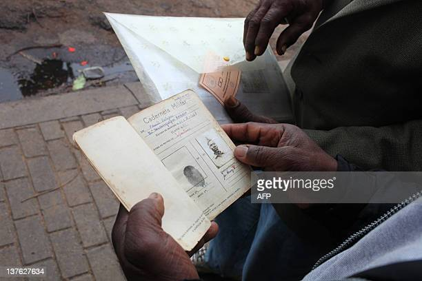 Johannes Myburgh A former soldier in the Portuguese colonial army in Mozambique looks at the military identity documents of fellow veteran Paulo...