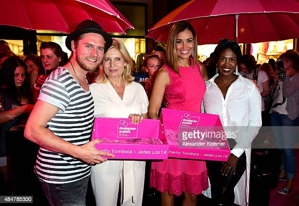 Johannes Oerding, Sabine Postel, Jana Ina Zarella and Motsi Mabuse are pictured during the Late Night Shopping at Designer Outlet Soltau on August...