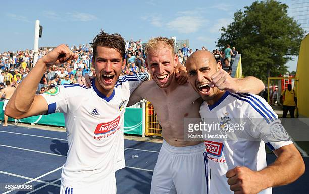 Johannes Pieles Justin Gerlach and Velimir Jovanovic of Jena celebrate the victory during the First Round of DFBCup between FC Carl Zeiss Jena and...