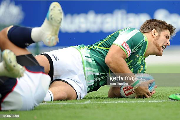 Johannes Prinsloo of South Africa scores a try during the match between South Africa and United States on day one of the Gold Coast Sevens World...