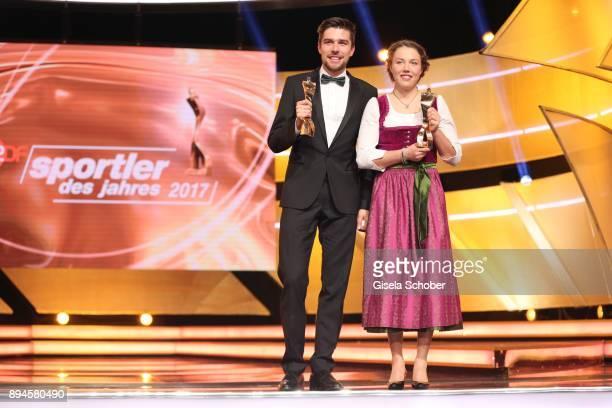 Johannes Rydzek and Biathlete Laura Dahlmeier with award during the 'Sportler des Jahres 2017' Gala at Kurhaus BadenBaden on December 17 2017 in...