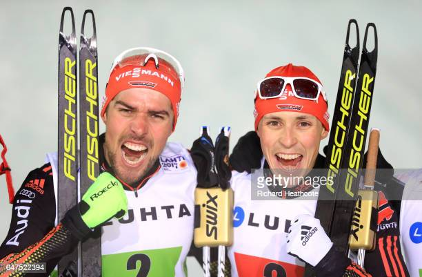 Johannes Rydzek and Eric Frenzel of Germany celebrate winning the gold medal in the Men's Nordic Combined HS130 Ski Jumping / 2 x 75km Team Sprint...