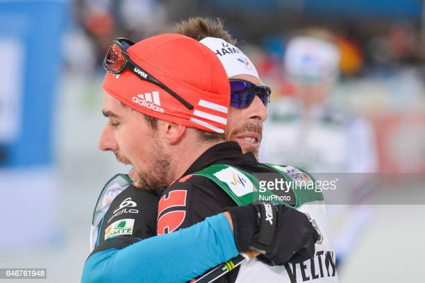 Johannes Rydzek from Germany receives congratulations from France's Francois Braud, after he wins Men 10km Nordic Combined final, at FIS Nordic World...