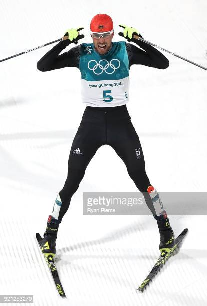 Johannes Rydzek of Germany celebrates after he crossed the line to win Gold in the Nordic Combined Individual Gundersen 10km CrossCountry on day...