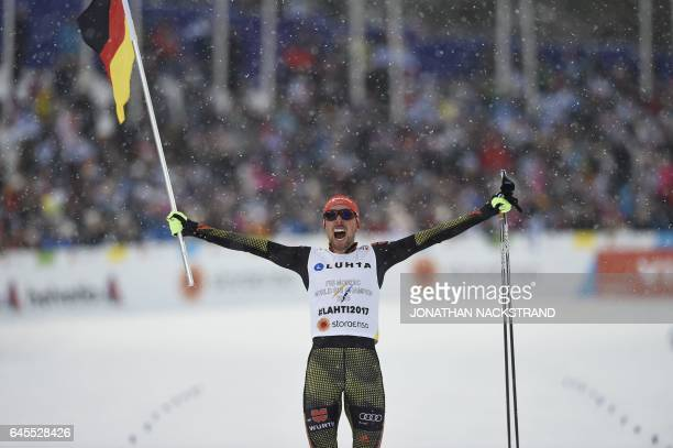 Johannes Rydzek of Germany celebrates at the finish line of the men's Nordic Combined Team Gundersen 4x5km of the FIS Nordic Ski World Championships...