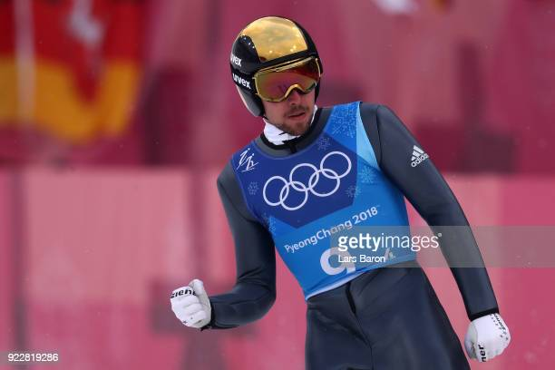 Johannes Rydzek of Germany celebrates during the Nordic Combined Team Gundersen LH/4x5km Ski Jumping Competition Round on day thirteen of the...