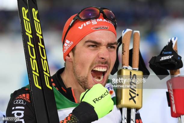Johannes Rydzek of Germany celebrates victory in the Men's Nordic Combined 10KM Cross Country during the FIS Nordic World Ski Championships on March...