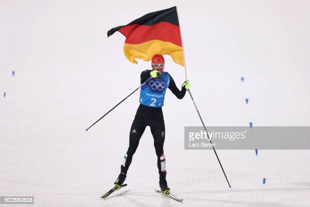 Johannes Rydzek of Germany celebrates winning gold during the Nordic Combined Team Gundersen LH/4x5km CrossCountry on day thirteen of the PyeongChang...