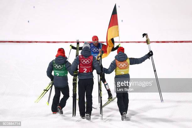 Johannes Rydzek of Germany celebrates winning gold with team mates Vinzenz Geiger of Germany Fabian Riessle of Germany and Eric Frenzel of Germany...