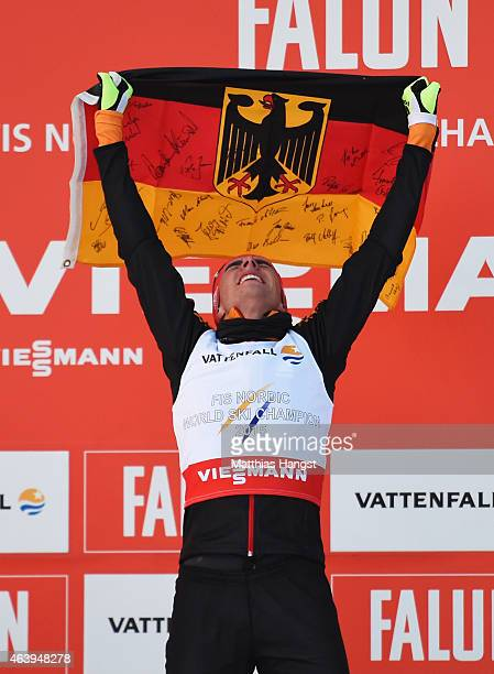 Johannes Rydzek of Germany celebrates winning the gold medal after the Men's Nordic Combined 10km CrossCountry during the FIS Nordic World Ski...