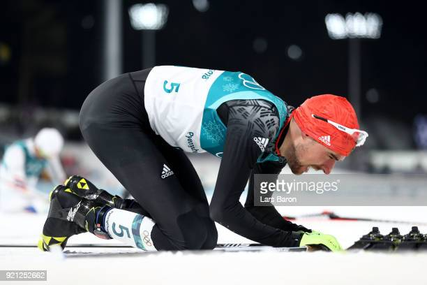 Johannes Rydzek of Germany celebrates winning the gold medal during the Nordic Combined Individual Gundersen 10km CrossCountry on day eleven of the...