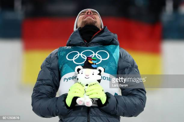 Johannes Rydzek of Germany celebrates winning the gold medal during the victory ceremony for the Nordic Combined Individual Gundersen 10km...