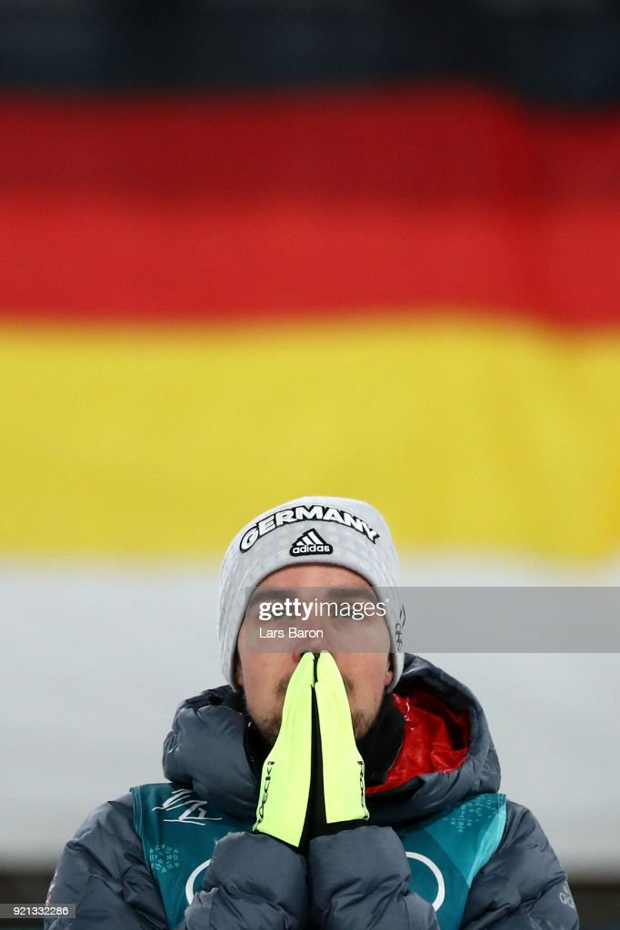 Johannes Rydzek of Germany celebrates winning the gold medal during the victory ceremony for the Nordic Combined Individual Gundersen 10km Cross-Country on day eleven of the PyeongChang 2018 Winter Olympic Games at Alpensia Cross-Country Skiing Centre on February 20, 2018 in Pyeongchang-gun, South Korea.