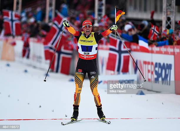 Johannes Rydzek of Germany celebrates winning the gold medal in the Nordic Combined 4 x 5km CrossCountry team event during the FIS Nordic World Ski...