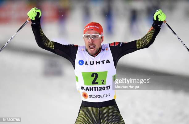 Johannes Rydzek of Germany celebrates winning the gold medal in the Men's Nordic Combined HS130 Ski Jumping / 2 x 75km Team Sprint Cross Country...
