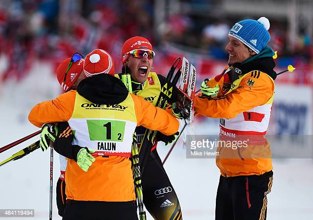 Johannes Rydzek of Germany celebrates winning the gold medal with team mates Tino Edelmann Eric Frenzel and Fabian Riessle in the Nordic Combined 4 x...