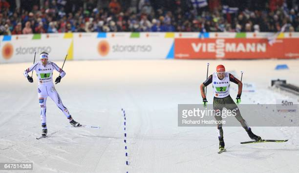 Johannes Rydzek of Germany heads for the finish line on the way to winning the gold medal with Magnus Krog of Norway in the Men's Nordic Combined...