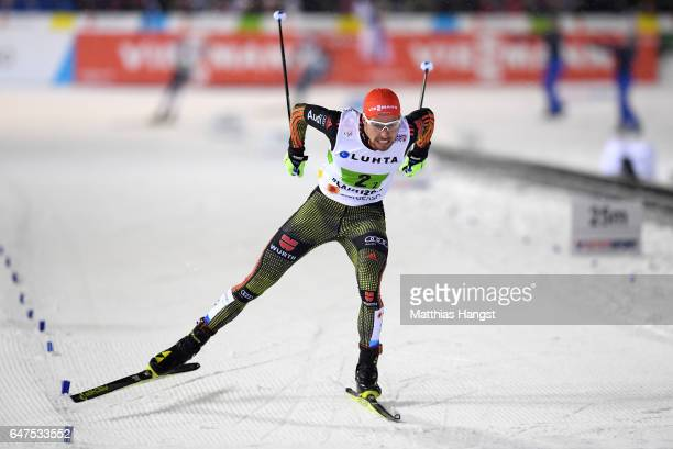 Johannes Rydzek of Germany heads for the finish line on the way to winning the gold medal in the Men's Nordic Combined HS130 Ski Jumping / 2 x 75km...