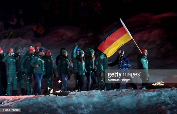 Johannes Rydzek of Germany is seen with the german flag during the opening ceremony for the FIS Nordic World Ski Championships on February 20 2019 in...