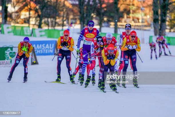 Johannes Rydzek of Germany, Mario Seidl of Austria and Espen Andersen of Norway competes during the Men's Gundersen Normal Hill HS98/10.0 Km at the...