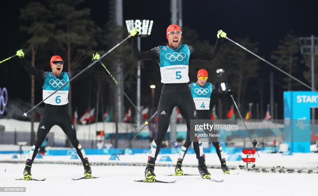 Johannes Rydzek (5) of Germany reacts after crossing the finish line to win the gold medal in the Nordic combined individual large hill event at the Pyeongchang Winter Olympics in South Korea on Feb. 20, 2018, followed by his compatriots, silver medalist Fabian Riessle (6) and bronze medalist Eric Frenzel. ==Kyodo