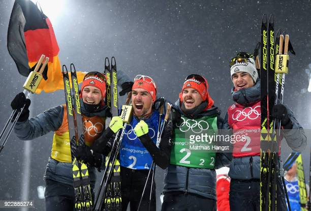 Johannes Rydzek of Germany Vinzenz Geiger of Germany Fabian Riessle of Germany and Eric Frenzel of Germany celebrate winning gold during the Nordic...