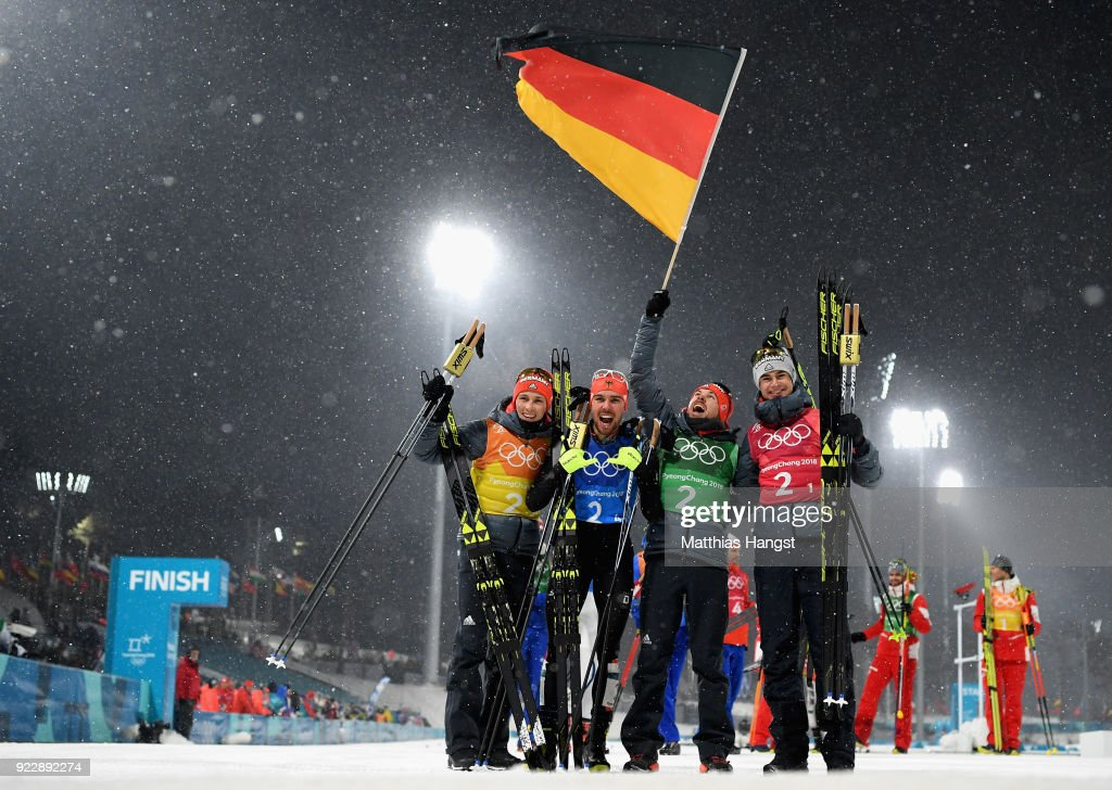 Johannes Rydzek of Germany, Vinzenz Geiger of Germany, Fabian Riessle of Germany and Eric Frenzel of Germany celebrate winning gold during the Nordic Combined Team Gundersen LH/4x5km, Cross-Country on day thirteen of the PyeongChang 2018 Winter Olympic Games at Alpensia Cross-Country Centre on February 22, 2018 in Pyeongchang-gun, South Korea.