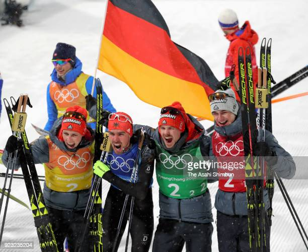 Johannes Rydzek of Germany Vinzenz Geiger of Germany Fabian Riessle of Germany and Eric Frenzel of Germany celebrate winning the gold medal after the...