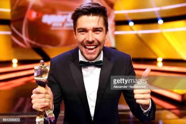 Johannes Rydzek poses with the 'Sportler des Jahres 2017' Gala award during the 'Sportler des Jahres 2017' Gala at Kurhaus Baden-Baden on December...