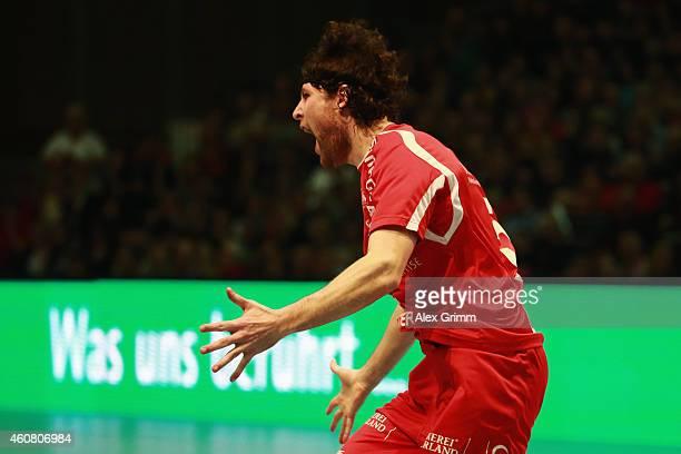 Johannes Sellin of Melsungen celebrates a goal during the DKB Handball Bundesliga match between MT Melsungen and SG FlensburgHandewitt at...