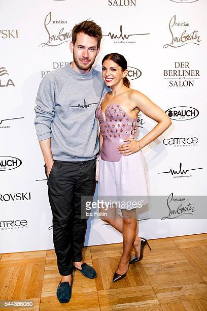 Johannes Strate singer of the band Revolverheld and his girlfriend german actress Anna Angelina Wolfers attend the Marina Hoermanseder defilee during...