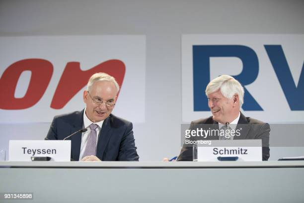 Johannes Teyssen chief executive officer of EON SE left and Rolf Schmitz chief executive officer of RWE AG react during a news conference in Essen...