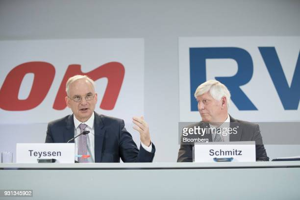 Johannes Teyssen chief executive officer of EON SE left speaks as he sits beside Rolf Schmitz chief executive officer of RWE AG during a news...