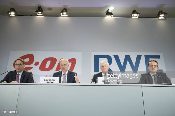 Johannes Teyssen chief executive officer of EON SE second left speaks as he sits with Marc Spieker chief financial officer of EON SE left Rolf...