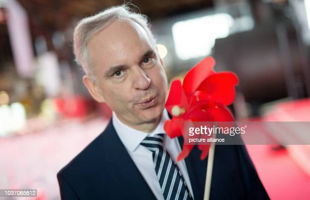 Johannes Teyssen poses with a small wind turbine as he attends the official inaugural cermony of the 'Amrumbank West' offshore wind park in Hamburg...