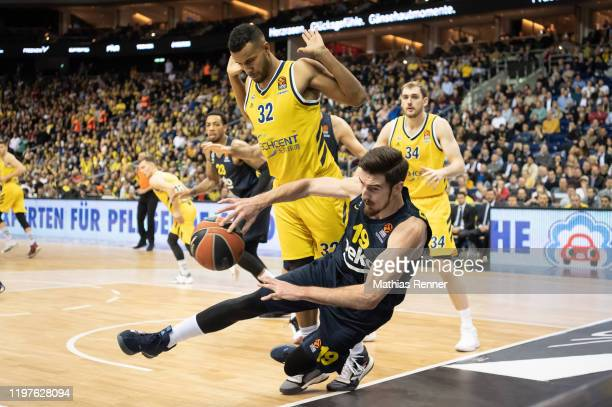 Johannes Thiemann of Alba Berlin and Nando De Colo of Fenerbahce Istanbul during the EuroLeague match between Alba Berlin and Fenerbahce Istanbul at...
