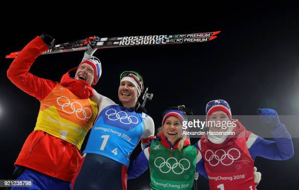 Johannes Thingnes Boe Emil Hegle Svendsen Tiril Eckhoff and Marte Olsbu of Norway celebrate after winning the silver medal during the Biathlon 2x6km...