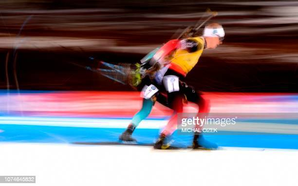 Johannes Thingnes Boe of Norway and Antonin Guigonnat of France compete during the men's 15 Km Mass Start competition of IBU World Cup Biathlon in...