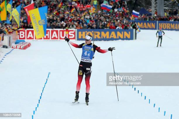 Johannes Thingnes Boe of Norway celebfrates victory ahead of Benedikt Doll of Germany during the Men 4x7.5 km Relay during the IBU Biathlon World Cup...