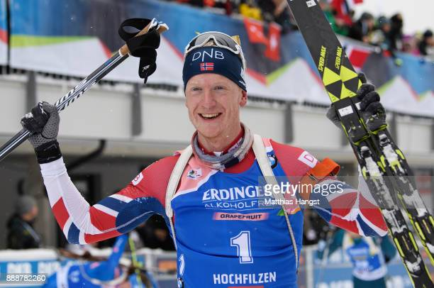 Johannes Thingnes Boe of Norway celebrates after winning the 125 km Men's Pursuit during the BMW IBU World Cup Biathlon on December 9 2017 in...